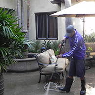 Residential pressure washing in backyard of Orange County home