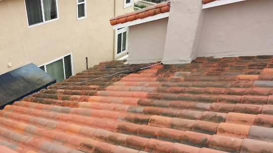 See the difference on this roof after just one blast of our pressure washer