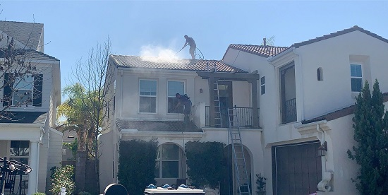 High cleaning a roof in orange county