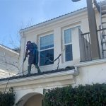 Pressure washing a roof in Orange County