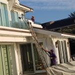 Cleaning the windows in a beautiful home in Orange County ca