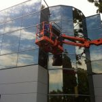 High in the sky washing windows at this commercial building in Orange County