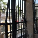 Reaching the tallest windows in Kaleidoscope in Mission Viejo