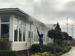 Pressure washing a roof