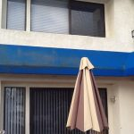 Picture of awning before it has been cleaned, covered in dirt and grim. Picture taken in Huntington Beach
