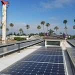 Before and after photos of solar panel cleaning