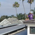 Scrubbing all the dirt and mess off solar panels