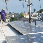 Hard at work cleaning these large solar panels in OC