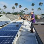 keeping the sun off our heads as we clean this large set of solar panels in Huntington Beach